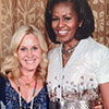 Katie Rocks wearing Samantha Sung cardigan and dress at the White House with Michelle Obama